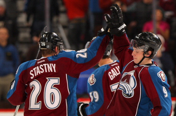DENVER, CO - DECEMBER 23:  Paul Stastny #26 and Matt Duchene #9 of the Colorado Avalanche celebrate after Duchene's game winning overtime goal against the Tampa Bay Lightning at the Pepsi Center on December 23, 2011 in Denver, Colorado. The Avalanche defeated the Lighning 2-1 in overtime.  (Photo by Doug Pensinger/Getty Images)