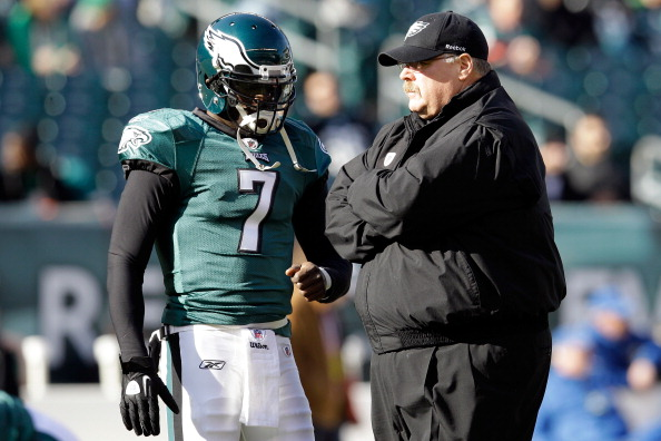 PHILADELPHIA, PA - JANUARY 01:  Michael Vick #7 of the Philadelphia Eagles talks with head coach Andy Reid before the start of the Eagles game against the Washington Redskins at Lincoln Financial Field on January 1, 2012 in Philadelphia, Pennsylvania.  (Photo by Rob Carr/Getty Images)