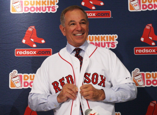 BOSTON, MA - DECEMBER 01:  Bobby Valentine puts on a Red Sox jersey during a press conference introducing him as the new manager of the Boston Red Sox at Fenway Park on December 1, 2011 in Boston, Massachusetts.  (Photo by Elsa/Getty Images)