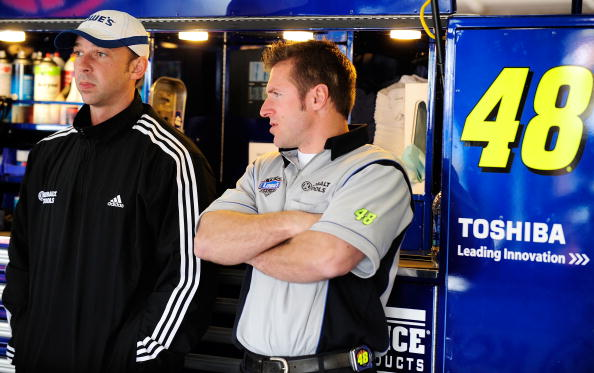 FONTANA, CA - FEBRUARY 19:  Chad Knaus, crew chief for the #48 Lowe's Chevrolet, stands in the garage area with car chief Ron Malec, during practice for the NASCAR Sprint Cup Series Auto Club 500 at Auto Club Speedway on February 19, 2010 in Fontana, California.  (Photo by Rusty Jarrett/Getty Images for NASCAR)