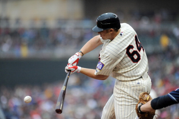 MINNEAPOLIS, MN - SEPTEMBER 18:  Chris Parmelee #64 of the Minnesota Twins lines one out in the first inning against Cleveland Indians at Target Field on September 18, 2011 in Minneapolis, Minnesota.  (Photo by Marilyn Indahl/Getty Images)