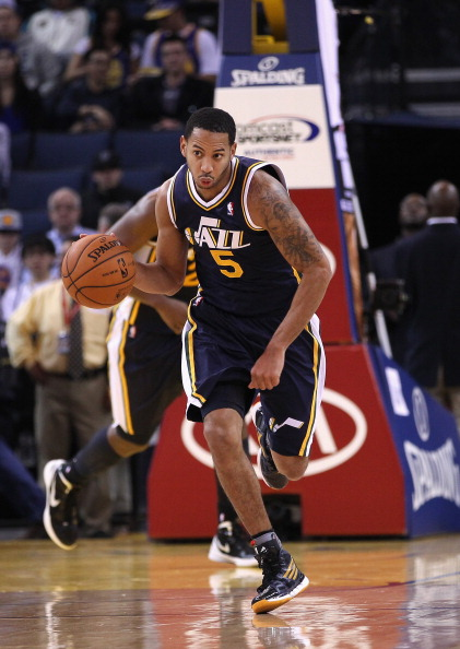 OAKLAND, CA - JANUARY 07:  Devin Harris #5 of the Utah Jazz in action against the Golden State Warriors at Oracle Arena on January 7, 2012 in Oakland, California.  NOTE TO USER: User expressly acknowledges and agrees that, by downloading and or using this photograph, User is consenting to the terms and conditions of the Getty Images License Agreement.  (Photo by Ezra Shaw/Getty Images)