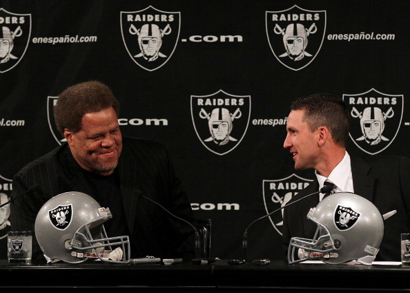 ALAMEDA, CA - JANUARY 30:  New Oakland Raiders head coach Dennis  Allen (R) talks with Raiders general manager Reggie McKenzie (L) looks on during a press conference on January 30, 2012 in Alameda, California. Dennis Allen was introduced as the new coach of the Oakland Raiders, replacing Hue Jackson who was fired after one season.  (Photo by Justin Sullivan/Getty Images)