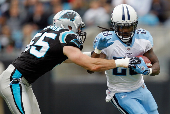 CHARLOTTE, NC - NOVEMBER 13:   Chris Johnson #28 of the Tennessee Titans is tackled by Dan Connor #55 of the Carolina Panthers during their game at Bank of America Stadium on November 13, 2011 in Charlotte, North Carolina.  (Photo by Streeter Lecka/Getty Images)