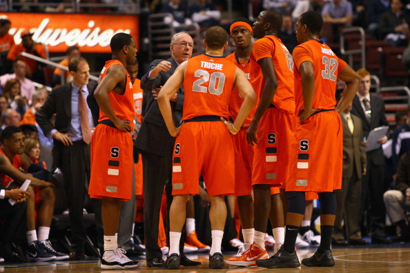 PHILADELPHIA, PA - JANUARY 11:  Head coach Jim Boeheim of the Syracuse Orange talks with (in uniform L-R) Scoop Jardine #11, Brandon Triche #20, C.J. Fair #5, Baye Moussa Keita #12 and Kris Joseph #32 during a timeout against the Villanova Wildcats at the Wells Fargo Center on January 11, 2012 in Philadelphia, Pennsylvania.  (Photo by Chris Chambers/Getty Images)