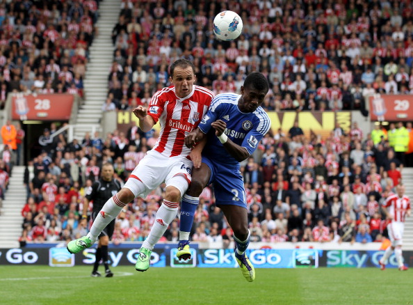 STOKE ON TRENT, ENGLAND - AUGUST 14:  Matthew Etherington of Stoke and Salomon Kalou of Chelsea compete for a header during the Barclays Premier League match between Stoke City and Chelsea at the Britannia Stadium on August 14, 2011 in Stoke on Trent, England.  (Photo by Clive Brunskill/Getty Images)