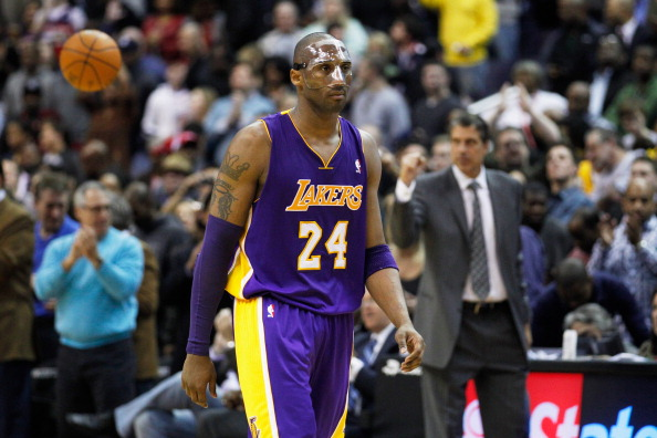 WASHINGTON, DC - MARCH 07: Kobe Bryant #24 of the Los Angeles Lakers walks off the floor after the Lakers lost 106-101 to the Washington Wizards at the Verizon Center on March 7, 2012 in Washington, DC. NOTE TO USER: User expressly acknowledges and agrees that, by downloading and or using this photograph, User is consenting to the terms and conditions of the Getty Images License Agreement.  (Photo by Rob Carr/Getty Images)