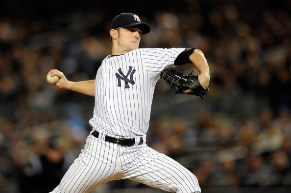 NEW YORK, NY - OCTOBER 06:  David Robertson #30 of the New York Yankees throws a pitch against the Detroit Tigers during Game Five of the American League Championship Series at Yankee Stadium on October 6, 2011 in the Bronx borough of New York City.  (Photo by Patrick McDermott/Getty Images)