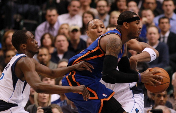 DALLAS, TX - MARCH 06:  Carmelo Anthony #7 of the New York Knicks dribbles the ball against Shawn Marion #0 and Rodrigue Beaubois #3 of the Dallas Mavericks at American Airlines Center on March 6, 2012 in Dallas, Texas.  NOTE TO USER: User expressly acknowledges and agrees that, by downloading and or using this photograph, User is consenting to the terms and conditions of the Getty Images License Agreement.  (Photo by Ronald Martinez/Getty Images)