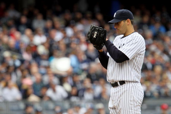 NEW YORK - APRIL 13:  Starting pitcher Andy Pettitte #46 of the New York Yankees looks towards home plate against the Los Angeles Angels of Anaheim during the Yankees home opener at Yankee Stadium on April 13, 2010 in the Bronx borough of New York City.  (Photo by Jim McIsaac/Getty Images)