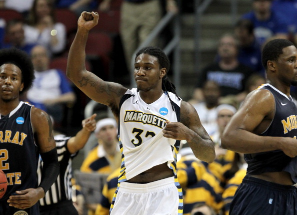 LOUISVILLE, KY - MARCH 17:  Jae Crowder #32 of the Marquette Golden Eagles celebrates the 62-53 victory against the Murray State Racers during the third round of the 2012 NCAA Men's Basketball Tournament at KFC YUM! Center on March 17, 2012 in Louisville, Kentucky.  (Photo by Jonathan Daniel/Getty Images)
