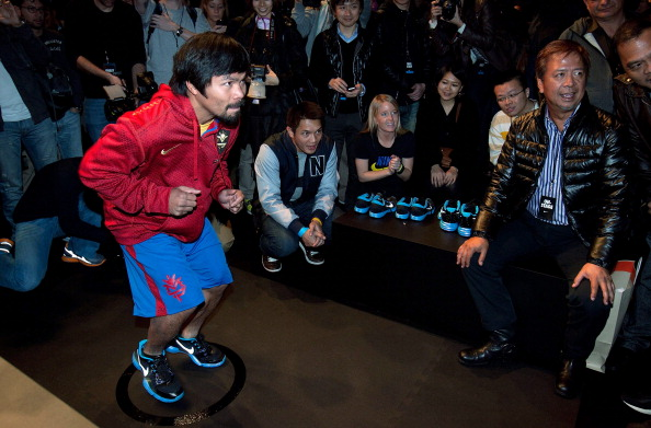 NEW YORK, NY - FEBRUARY 22:  Boxer Manny Pacquiao tests out Nike's new new basketball and training technology at Basketball City, Pier 36 on February 22, 2012 in New York City.  (Photo by Mike Lawrie/Getty Images)