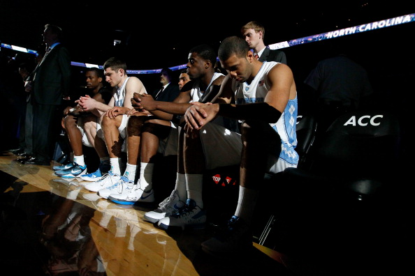 ATLANTA, GA - MARCH 11:  (L-R) Harrison Barnes #40, Tyler Zeller #44, James Michael McAdoo #43, Reggie Bullock #35 and Kendall Marshall #5 of the North Carolina Tar Heels sit on the bench during pregame against the Florida State Seminoles during the Final Game of the 2012 ACC Men's Basketball Conference Tournament at Philips Arena on March 11, 2012 in Atlanta, Georgia.  (Photo by Kevin C. Cox/Getty Images)
