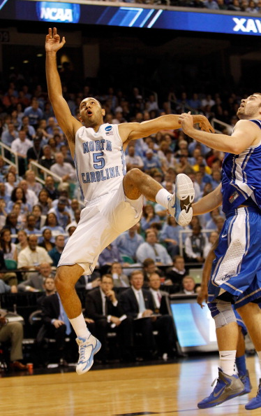 GREENSBORO, NC - MARCH 18:  Kendall Marshall #5 of the North Carolina Tar Heels is fouled by Ethan Wragge #34 of the Creighton Bluejays in the second half during the third round of the 2012 NCAA Men's Basketball Tournament at Greensboro Coliseum on March 18, 2012 in Greensboro, North Carolina. Marshall injured his right wrist on the play.  (Photo by Streeter Lecka/Getty Images)