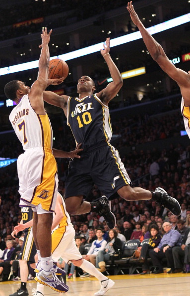 LOS ANGELES, CA - MARCH 18:  Alec Burks #10 of the Utah Jazz shoots over Ramon Sessions #7 of the Los Angeles Lakers at Staples Center on March 18, 2012 in Los Angeles, California.   NOTE TO USER: User expressly acknowledges and agrees that, by downloading and or using this photograph, User is consenting to the terms and conditions of the Getty Images License Agreement.  (Photo by Stephen Dunn/Getty Images)