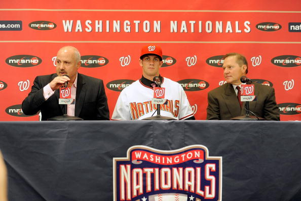 WASHINGTON - AUGUST 26:  General Manger Mike Rizzo, Bryce Harper #34 of the Washington Nationals and Scott Boras talk to the media during a press conference at Nationals Park on August 26, 2010 in Washington, DC.  (Photo by Greg Fiume/Getty Images)