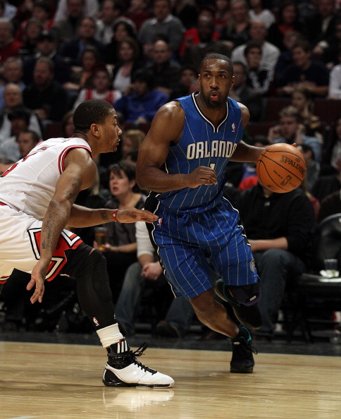 CHICAGO, IL - JANUARY 28: Gilbert Arenas #1 of the Orlando Magic moves against Derrick Rose #1 of the Chicago Bulls at the United Center on January 28, 2011 in Chicago, Illinois. The Bulls defeated the Magic 99-90. NOTE TO USER: User expressly acknowledges and agrees that, by downloading and/or using this photograph, User is consenting to the terms and conditions of the Getty Images License Agreement. (Photo by Jonathan Daniel/Getty Images)