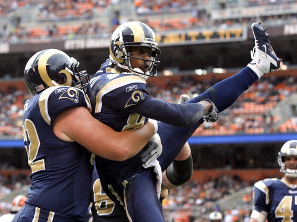 CLEVELAND, OH - NOVEMBER 13:  Wide receiver Brandon Lloyd #83 of the St. Louis Rams celebrates after scoring a touchdown with Harvey Dahl #62 against the Cleveland Browns at Cleveland Browns Stadium on November 13, 2011 in Cleveland, Ohio.  (Photo by Matt Sullivan/Getty Images)