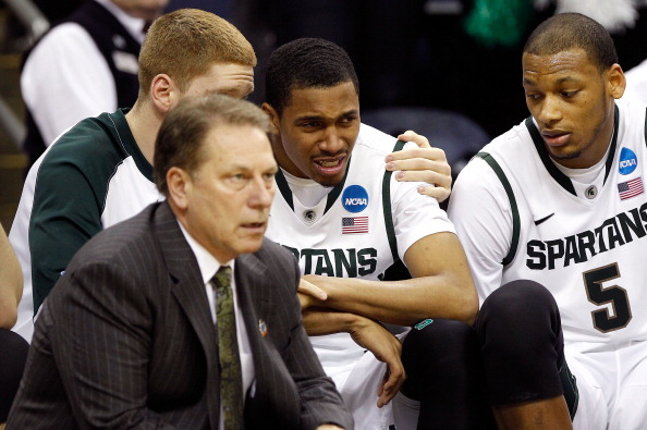 COLUMBUS, OH - MARCH 18:  Brandan Kearney #3 of the Michigan State Spartans sits on the bench speaking to head coach Tom Izzo after committing a foul against the St. Louis Billikens in the second half during the third round of the 2012 NCAA Men's basketball tournament at Nationwide Arena on March 18, 2012 in Columbus, Ohio.  (Photo by Rob Carr/Getty Images)