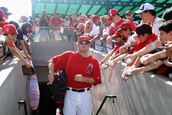 TEMPE, AZ - MARCH 10:  Mark Trumbo #44 of the Los Angeles Angels of Anaheim walks out onto the field past fans before the spring training game against the San Francisco Giants at Tempe Diablo Stadium on March 10, 2012 in Tempe, Arizona.  (Photo by Christian Petersen/Getty Images)