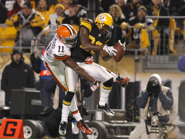 PITTSBURGH, PA - DECEMBER 8:   William Gay #22 of the Pittsburgh Steelers intercepts a pass to Mohamed Massaquoi #11 of the Cleveland Browns during the game on December 8, 2011 at Heinz Field in Pittsburgh, Pennsylvania.  The Steelers won 14-3.  (Photo by Justin K. Aller/Getty Images)