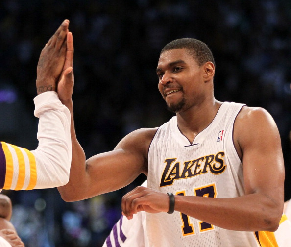 LOS ANGELES, CA - MARCH 11: Andrew Bynum #17 of the Los Angeles Lakers celebrates after the game with the Boston Celtics at Staples Center on March 11, 2012 in Los Angeles, California.  The Lakers won 97-94.  NOTE TO USER: User expressly acknowledges and agrees that, by downloading and or using this photograph, User is consenting to the terms and conditions of the Getty Images License Agreement.  (Photo by Stephen Dunn/Getty Images)