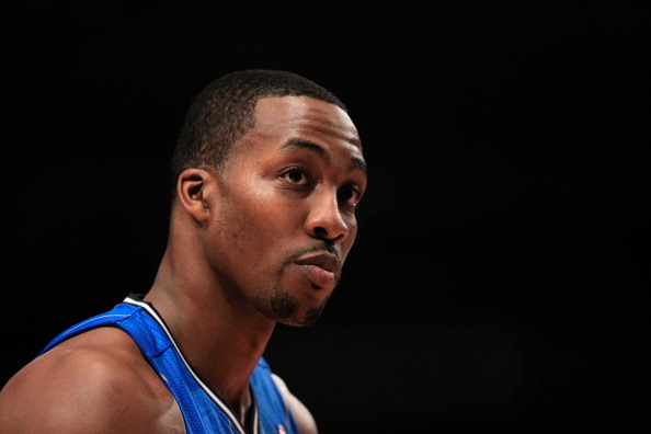 NEW YORK, NY - MARCH 28: Dwight Howard #12 of the Orlando Magic looks on against the New York Knicks at Madison Square Garden on March 28, 2012 in New York City. NOTE TO USER: User expressly acknowledges and agrees that, by downloading and/or using this Photograph, user is consenting to the terms and conditions of the Getty Images License Agreement.  (Photo by Chris Trotman/Getty Images)