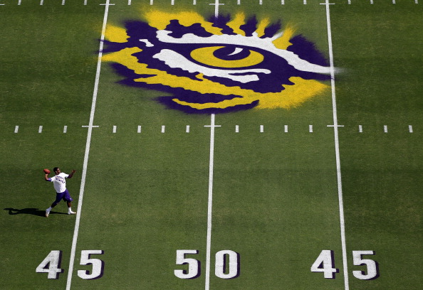 BATON ROUGE, LA - OCTOBER 22:  A player warms up in front of a detail of the logo on the field of the LSU Tigers prior to the the game against the Auburn Tigers at Tiger Stadium on October 22, 2011 in Baton Rouge, Louisiana.  (Photo by Jamie Squire/Getty Images)