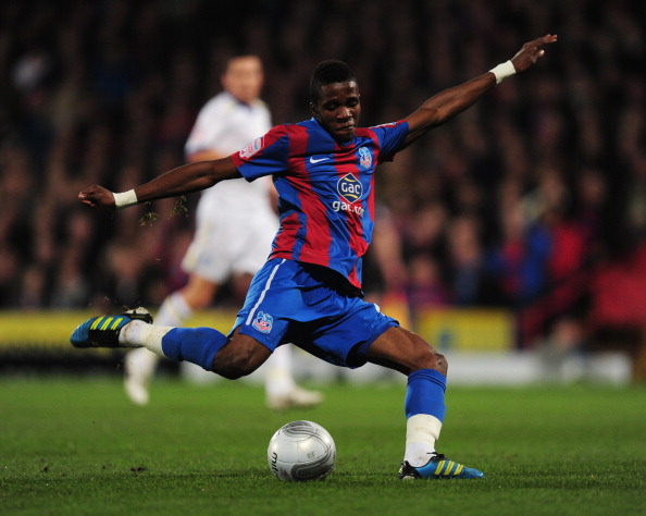 LONDON, ENGLAND - JANUARY 10:  Wilfried Zaha of Crystal Palace shoots during the Carling Cup Semi Final First Leg match between Crystal Palace and Cardiff City at Selhurst Park on January 10, 2012 in London, England.  (Photo by Jamie McDonald/Getty Images)