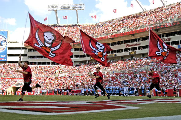 TAMPA, FL - OCTOBER 14: Flag bearers of the Tampa Bay Buccaneers celebrate a score during play against the Tennessee Titans at Raymond James Stadium on October 14, 2007 in Tampa, Florida.  The Bucs won 13-10.(Photo by Al Messerschmidt/Getty Images) *** Local Caption ***