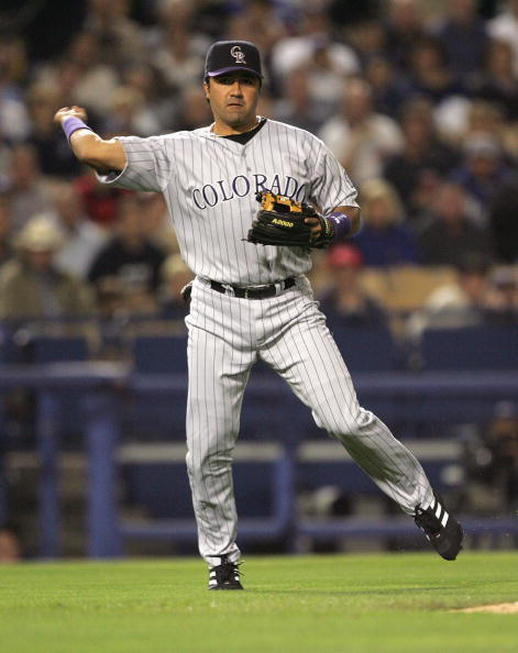 LOS ANGELES - SEPTEMBER 29:  Infielder Vinny Castilla #9 of the Colorado Rockies throws the ball during the game against the Los Angeles Dodgers at Dodger Stadium on September 29, 2004 in Los Angeles, California. The Rockies won 4-1. (Photo by Jeff Gross/Getty Images)