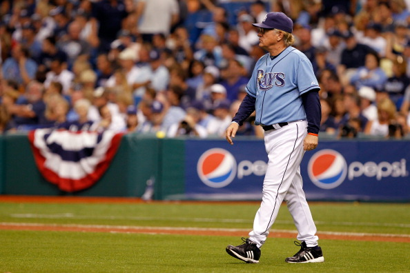 ST PETERSBURG, FL - OCTOBER 04:  Manager Joe Maddon walks out to the mound in the seventh inning while taking on the Texas Rangers in Game Four of the American League Division Series at Tropicana Field on October 4, 2011 in St Petersburg, Florida.  (Photo by Mike Ehrmann/Getty Images)