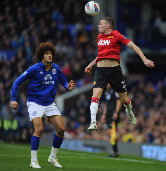 LIVERPOOL, ENGLAND - OCTOBER 29:  Marouane Fellaini of Everton in action with Tom Cleverley of Manchester United during the Barclays Premier League match between Everton and Manchester United at Goodison Park on October 29, 2011 in Liverpool, England.  (Photo by Michael Regan/Getty Images)