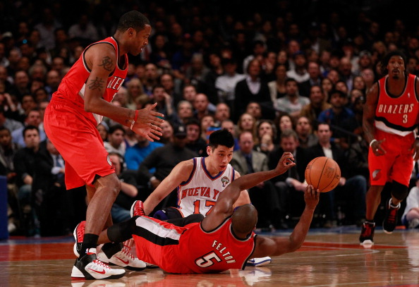 NEW YORK, NY - MARCH 14: (C) Jeremy Lin #17 of the New York Knicks battles for a loose ball foul with Marcus Camby #23 of the Portland Trail Blazers and Raymond Felton #5 of the Portland Trail Blazers  at Madison Square Garden on March 14, 2012 in New York City. NOTE TO USER: User expressly acknowledges and agrees that, by downloading and/or using this Photograph, user is consenting to the terms and conditions of the Getty Images License Agreement.  (Photo by Chris Trotman/Getty Images)