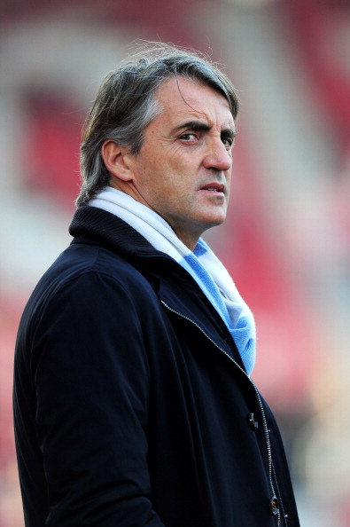 STOKE ON TRENT, ENGLAND - MARCH 24:  Roberto Mancini the manager of Manchester City looks  on prior to kickoff during the Barclays Premier League match between Stoke City and Manchester City at the Britannia Stadium on March 24, 2012 in Stoke on Trent, England.  (Photo by Shaun Botterill/Getty Images)