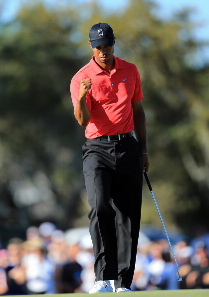 ORLANDO, FL - MARCH 25:  Tiger Woods of the USA celebrates holing a difficult par putt at the par 4, 15th hole during the final round of the 2012 Arnold Palmer Invitational presented by MasterCard at Bay Hill Club and Lodge on March 25, 2012 in Orlando, Florida.  (Photo by David Cannon/Getty Images)
