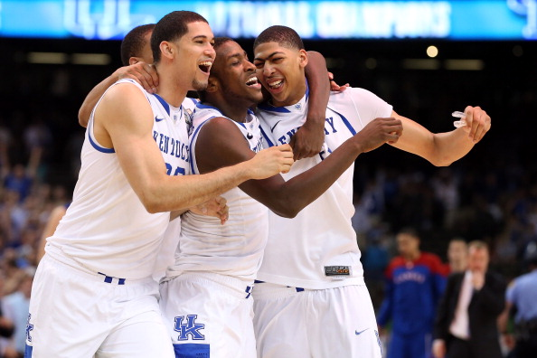 NEW ORLEANS, LA - APRIL 02:  Eloy Vargas #30, Darius Miller #1, Anthony Davis #23 and Twany Beckham #10 of the Kentucky Wildcats celebrate defeating the Kansas Jayhawks 67-59 in the National Championship Game of the 2012 NCAA Division I Men's Basketball Tournament at the Mercedes-Benz Superdome on April 2, 2012 in New Orleans, Louisiana.  (Photo by Jeff Gross/Getty Images)