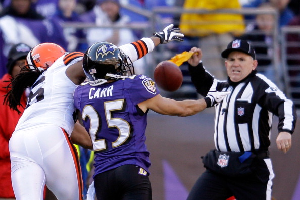 BALTIMORE, MD - DECEMBER 24: Field judge Greg Gautreaux calls pass interference on Chris Carr #25 of the Baltimore Ravens as Carr goes up for pass with Josh Cribbs #16 of the Cleveland Browns at M&T Bank Stadium on December 24, 2011 in Baltimore, Maryland.  (Photo by Rob Carr/Getty Images)