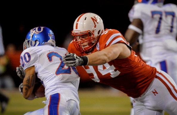 LINCOLN, NE - NOVEMBER 13: Jared Crick #94 of the Nebraska Cornhuskers runs down D.J. Beshears #20 of the Kansas Jayhawks during first half action of their game at Memorial Stadium on November 13, 2010 in Lincoln, Nebraska.  (Photo by Eric Francis/Getty Images)