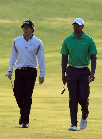 ABU DHABI, UNITED ARAB EMIRATES - JANUARY 26:  Rory McIlroy of Northern Ireland (L) and Tiger Woods of the USA walk to the green on the par 4, 11th hole during the first round of the Abu Dhabi HSBC Championship at the Abu Dhabi Golf Club on January 26, 2012 in Abu Dhabi, United Arab Emirates.  (Photo by David Cannon/Getty Images)