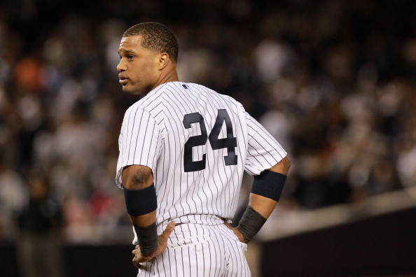 NEW YORK, NY - OCTOBER 06:  Robinson Cano #24 of the New York Yankees looks on against the Detroit Tigers during Game Five of the American League Championship Series at Yankee Stadium on October 6, 2011 in the Bronx borough of New York City. The Tigers won 3-2. (Photo by Nick Laham/Getty Images)