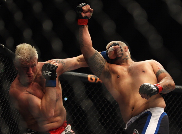 SYDNEY, AUSTRALIA - FEBRUARY 27:  Chris Tuchscherer of the United States is punched by Mark Hunt of Australia during their heavyweight bout as part of UFC 127 at Acer Arena on February 27, 2011 in Sydney, Australia.  (Photo by Mark Kolbe/Getty Images)