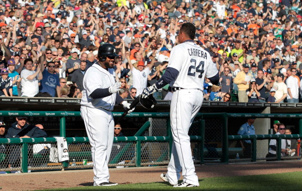 DETROIT, MI - APRIL 07:  Miguel Cabrera #24 of the Detroit Tigers hits a solo home run that was confirmed by video replay and celebrates with teammate Prince Fielder #28 in the fifth inning of the game against the Boston Red Sox at Comerica Park on April 7, 2012 in Detroit, Michigan.  (Photo by Leon Halip/Getty Images)
