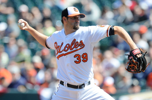BALTIMORE, MD - APRIL 08: Jason Hammel #39 of the Baltimore Orioles pitches against the Minnesota Twins at Oriole Park at Camden Yards on April 8, 2012 in Baltimore, Maryland. (Photo by Greg Fiume/Getty Images)