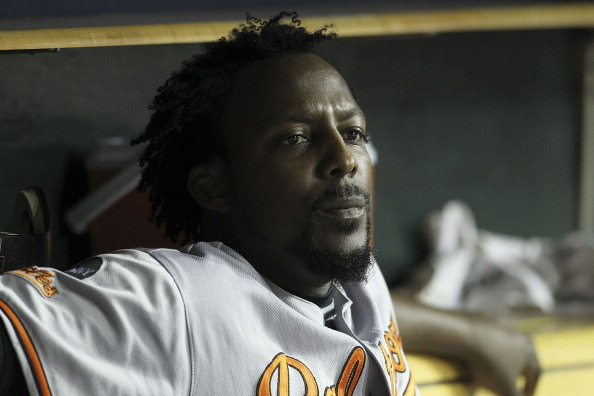 DETROIT - SEPTEMBER 22: Vladimir Guerrero #27 of the Baltimore Orioles watches the action from the dugout during the game against the Detroit Tigers at Comerica Park on September 22, 2011 in Detroit, Michigan. The Orioles defeated the Tigers 6-5. (Photo by Leon Halip/Getty Images)