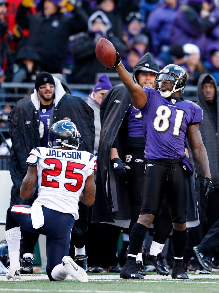 BALTIMORE, MD - JANUARY 15:  Anquan Boldin #81 of the Baltimore Ravens reacts as Kareem Jackson #25 of the Houston Texans looks on during the second quarter of the AFC Divisional playoff game at M&T Bank Stadium on January 15, 2012 in Baltimore, Maryland. Baltimore won 20-13 in regulation.  (Photo by Rob Carr/Getty Images)