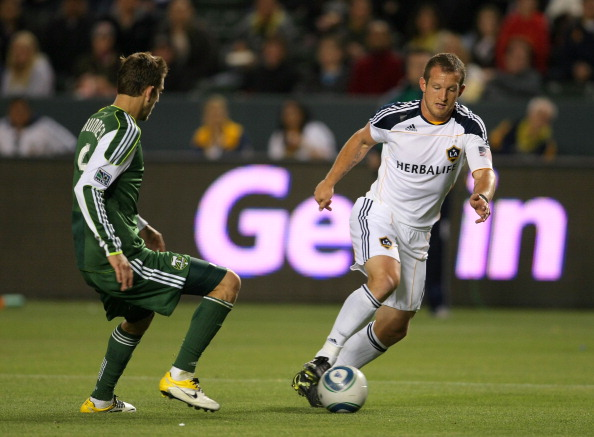 CARSON, CA - APRIL 23:  Chad Barrett #11 of the Los Angeles Galaxy dribbles the ball in the penalty box against Eric Brunner #5 of the Portland Timbers during the MLS match at The Home Depot Center on April 23, 2011 in Carson, California. The Galaxy defeated the Timbers 3-0.  (Photo by Victor Decolongon/Getty Images)