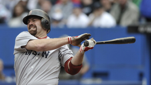 TORONTO, CANADA - SEPTEMBER 05:  Kevin Youkilis #20 of the Boston Red Sox bats during MLB game action against the Toronto Blue Jays September 5, 2011 at Rogers Centre in Toronto, Ontario, Canada. (Photo by Brad White/Getty Images)