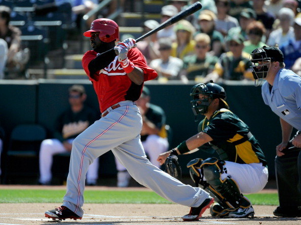 PHOENIX, AZ - MARCH 10:  Brandon Phillips #4 of the Cincinnati Reds plays in the spring training baseball game against the Oakland Athletics at the Phoenix Municipal Stadium on March 10, 2012 in Phoenix, Arizona.  (Photo by Kevork Djansezian/Getty Images)