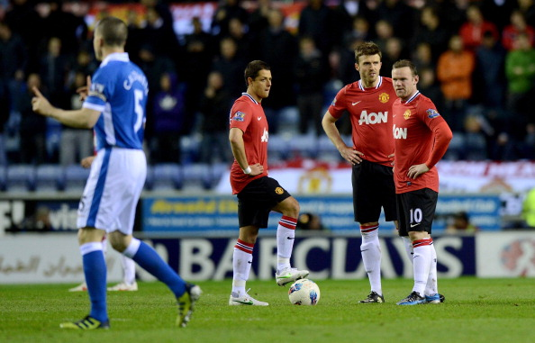 WIGAN, ENGLAND - APRIL 11:  Javier Hernandez, Michael Carrick and Wayne Rooney wait to kick off after Wigan's goal during the Barclays Premier League match between Wigan Athletic and Manchester United at DW Stadium on April 11, 2012 in Wigan, England.  (Photo by Gareth Copley/Getty Images)